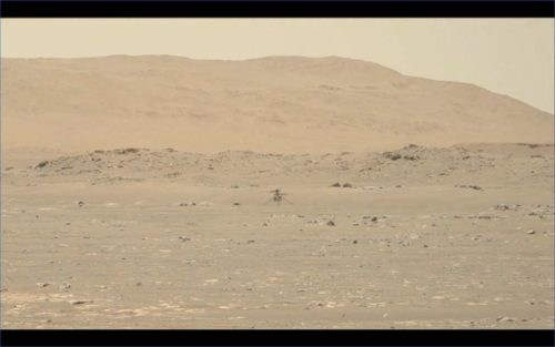 Image from a video of NASA's Ingenuity Helicopter in flight. The video was taken by NASA's Perseverance rover.