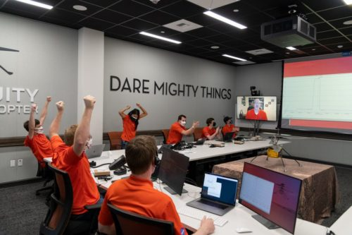 Picture of the Ingenuity team celebrating when they hear that the helicopter's flight on Mars was successful.