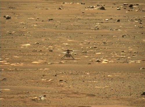 Picture of NASA's Ingenuity Helicopter after its first flight. The picture is taken by NASA's Perseverance rover.