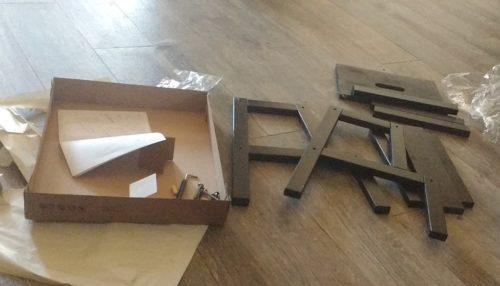 An unassembled IKEA flat pack stool