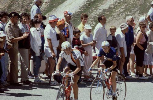 Two female cyclists pedal uphill during the women's Tour de France in July, 1986. Hautes-Alpes Col De L'Izoard Tour de France Feminin July, 1986