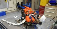 NASA's manikin dressed in an orange survival suit, positioned as it will be in the commander's seat in the Orion capsule.