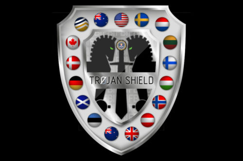 Shield graphic depicting flags of countries participating in Operation Trojan Shield.
