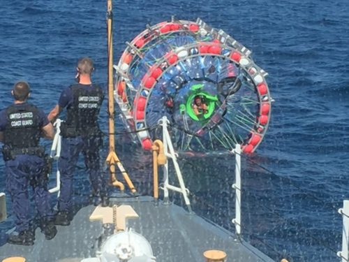 U.S. Coast Guard crews stopped Reza Baluchi (seen sticking his head out of his bubble craft) during his journey from Florida to Bermuda on Sunday.