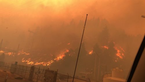 A hillside with utility lines on fire in one part of the Dixie Fire in California, July 22, 2021.