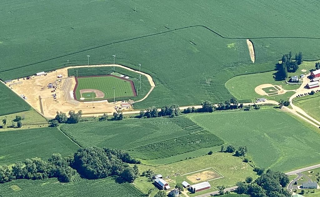 """Aerial view of ballparks near Dyersville, Iowa. The baseball field on the right side of the image is the location where the movie Field of Dreams was filmed. The ballpark on the left side of the image was constructed by Major League Baseball (MLB) to host the """"MLB at Field of Dreams"""" game, originally scheduled for the 2020 season but postponed to 2021."""