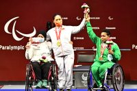 Yujiao Tan from China, gold medalist, Fatma Omar from Egypt, silver medalist, and Olaitan Ibrahim from Nigeria, bronze medalist in the women's up to 67kg at the Tokyo International Forum during the Paralympic Games on 28 August.