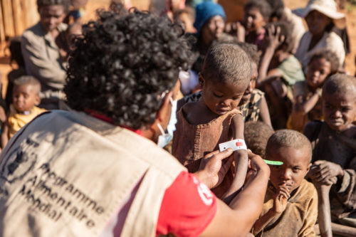 An aid worker measures the arm of a 4-year-old child in an area suffering from a lack of food due to a long-term drought in southern Madagascar.