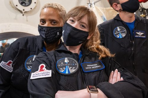 Altitude chamber training at Duke Health in Durham, North Carolina. Sian Proctor and Haley Arceneaux in masks.