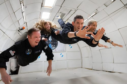 Crew of the Inspiration4 mission floating during weightlessness during ZERO-G flight