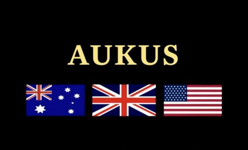 """Graphic with """"AUKUS"""" and the flags of Australia, UK, and the US."""