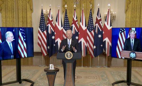 US President Joe Biden speaking about the AUKUS agreement, with Australian Prime Minister Scott Morrison (left) and UK Prime Minister Boris Johnson (right) on video screens.