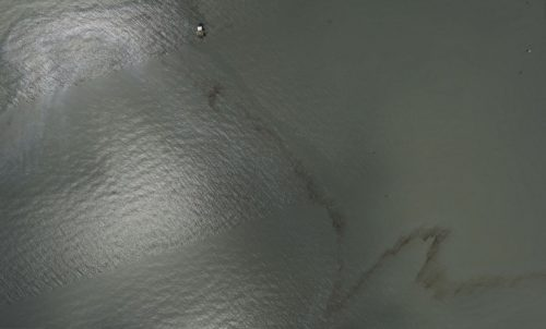A picture of an oil leak triggered by Hurricane Ida off the coast of Port Fourchon, Louisiana taken by a NOAA airplane on August 31.