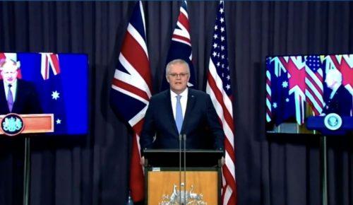 Australian Prime Minister Scott Morrison speaking about the AUKUS agreement, with US President Joe Biden (right) and UK Prime Minister Boris Johnson (left) on video screens.