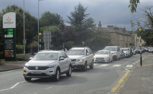 A long queue of cars waiting to purchase fuel during panic buying at Morrisons petrol station, Wetherby as a result of the 2021 United Kingdom fuel crisis