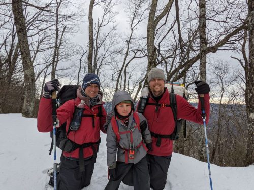 Josh, Cassie, and Harvey Sutton hiking the Appalachian Trail in the snow.