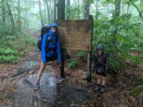 Cassie and Harvey Sutton hiking the Appalachian Trail in the rain.