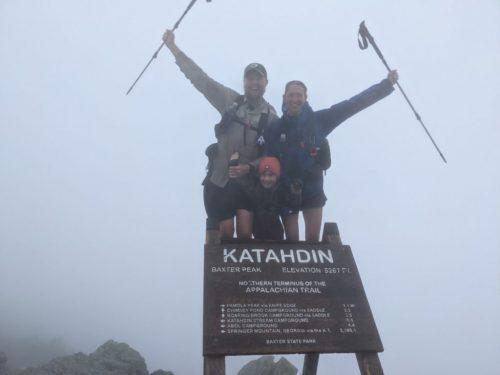 Josh, Cassie, and Harvey Sutton finish the Appalachian Trail at Mount Katahdin in Maine.