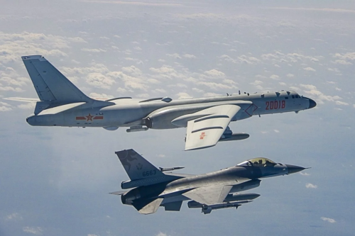 A ROC Airforce F-16 fighter jet shadows a PLA Airforce Bomber that had approached the island of Taiwan.