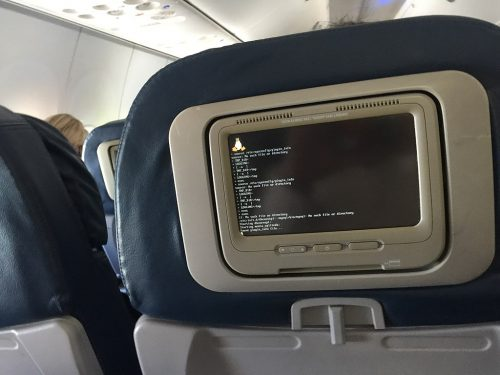 An in-flight entertainment system displaying the Linux boot screen